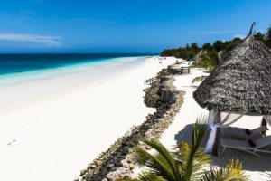 Beautiful Beach by the blue waters of the Indian ocean in Zanzibar. Zanzibar is an Island just off the coast of Tanzania - Africa.